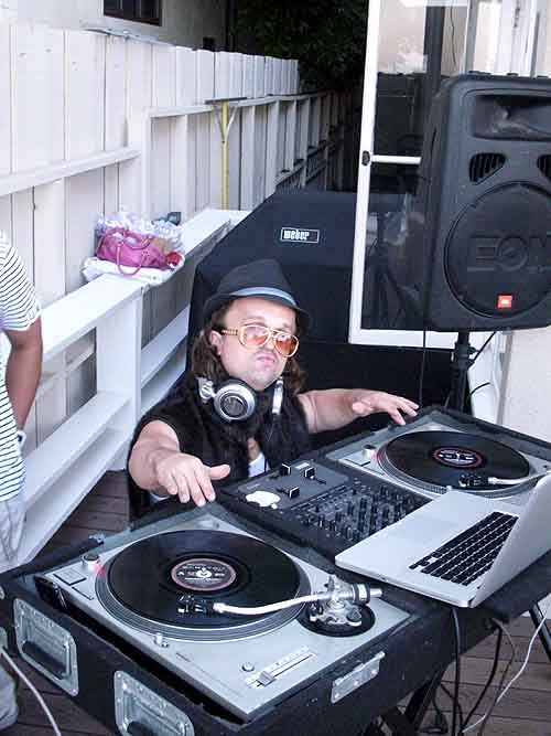 DJ Mighty Mike in character as Mini Kid Rock