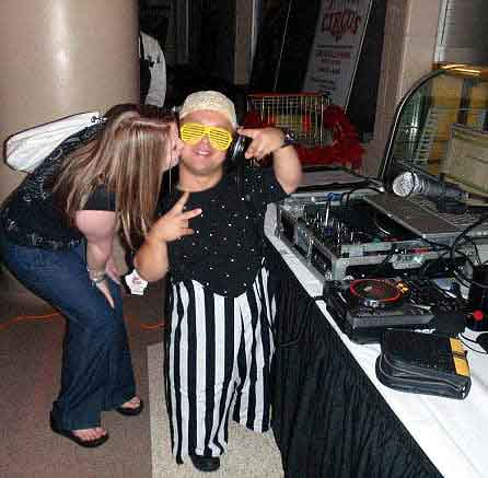 Kisses always make dwarf DJ Mighty Mike sound hotter